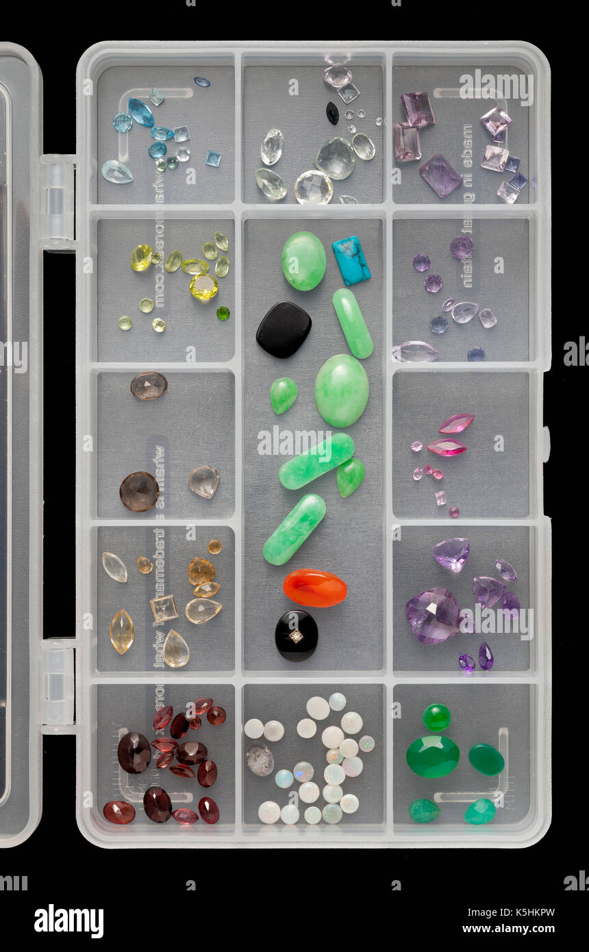 Collection of gemstones, minerals, for jewellery making in divided box - Stock Image