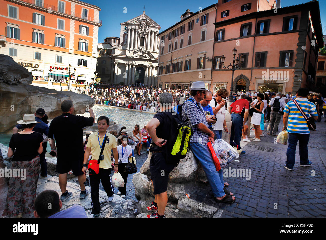 Trevi Fountain, Rome, Italy. Tourists at the Trevi Fountain. - Stock Image