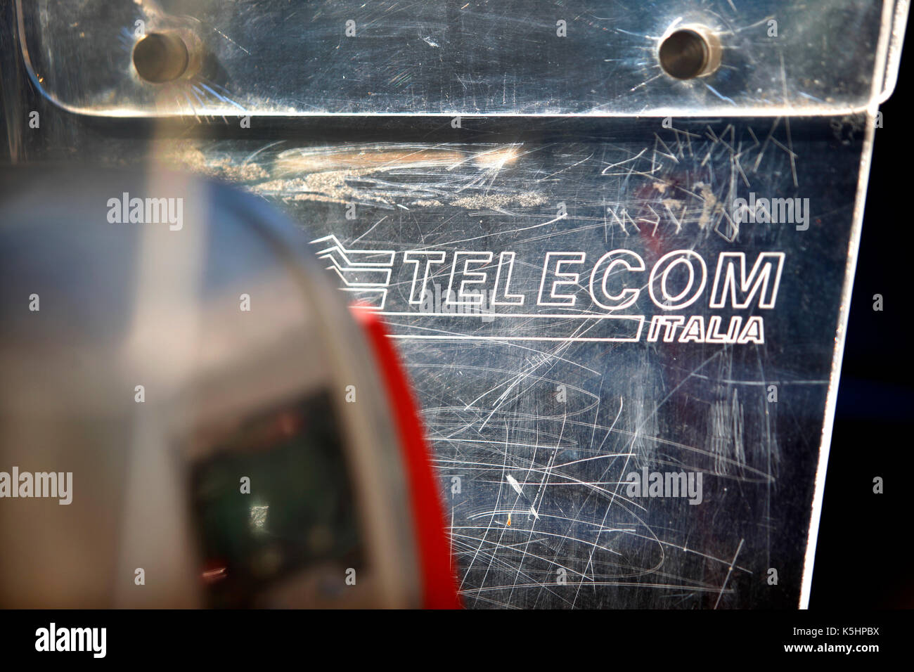 Scratched perspex on a Telecom Italia payphone, Penne, Italy. Picture has been reversed so that lettering is right way round. - Stock Image