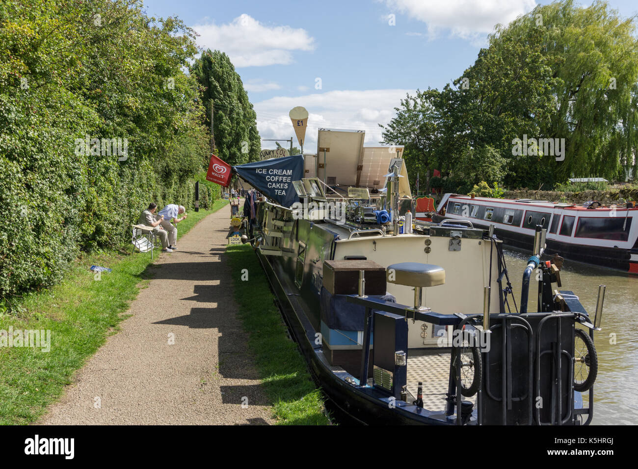 Narrowboat fitted out to sell teas and coffees on the canal at Stoke Bruerne Northamptonshire, UK - Stock Image