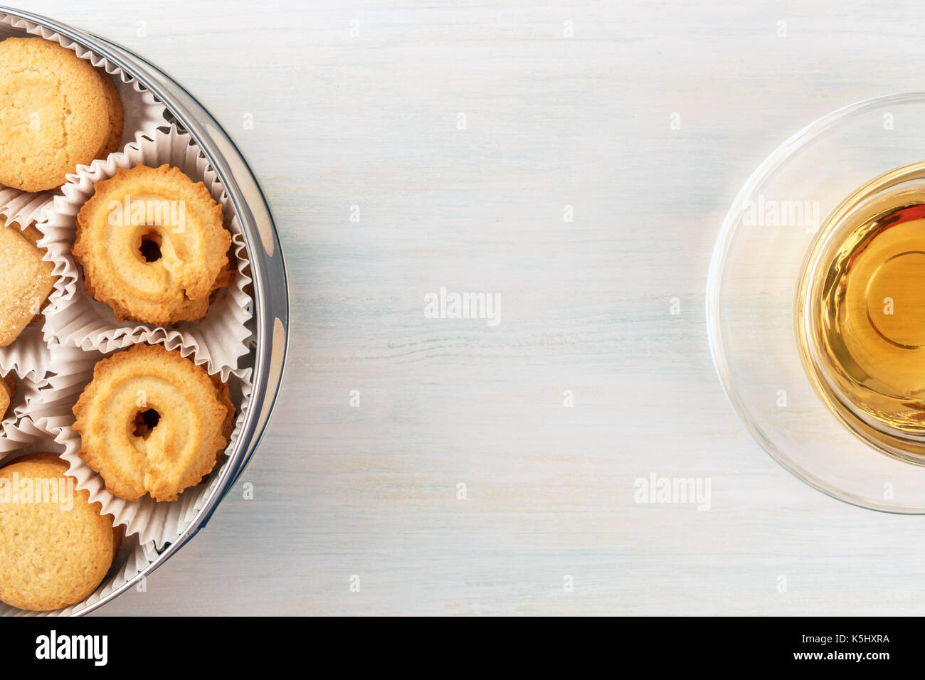 Overhead view of Danish butter cookies with tea and copyspace - Stock Image