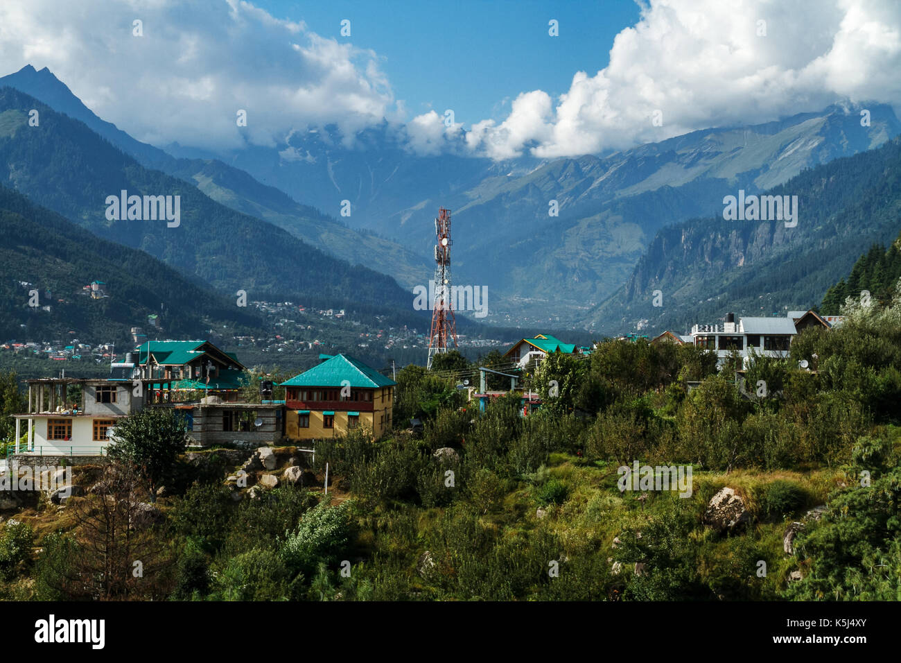 Mobile phone tower and Rohtang La backdrop, Himachal Pradesh - Stock Image