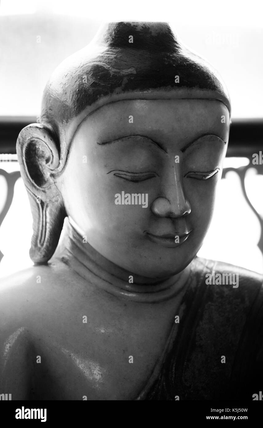 A marble statue of Buddha from Burma, Myanmar. Thought to be from 18th or 19th century it is now displayed in the Wisbech and Fenland  Museum. - Stock Image