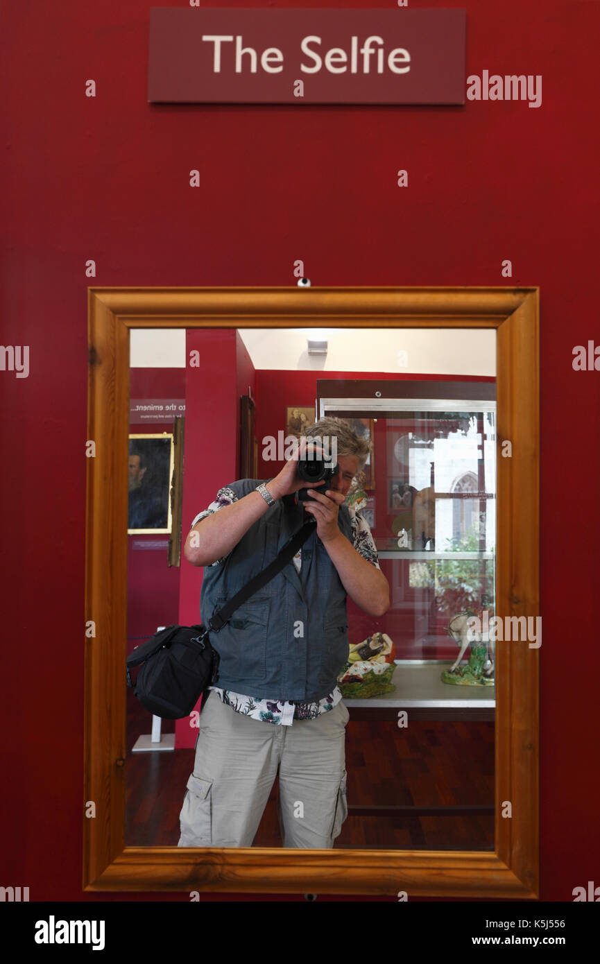 Photograph of self taken in a mirror with 'The Selfie' written above. - Stock Image