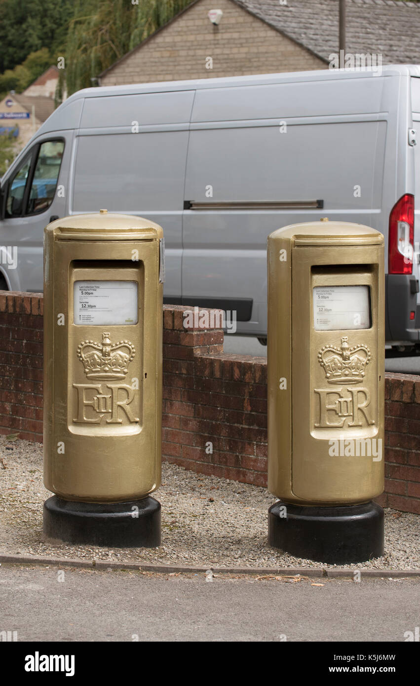 Royal Mail postboxes painted gold to celebrate an Olympic sucess. Rowers Reed & Gregory earned Gold in the Olympics. In celebration two postboxes have - Stock Image