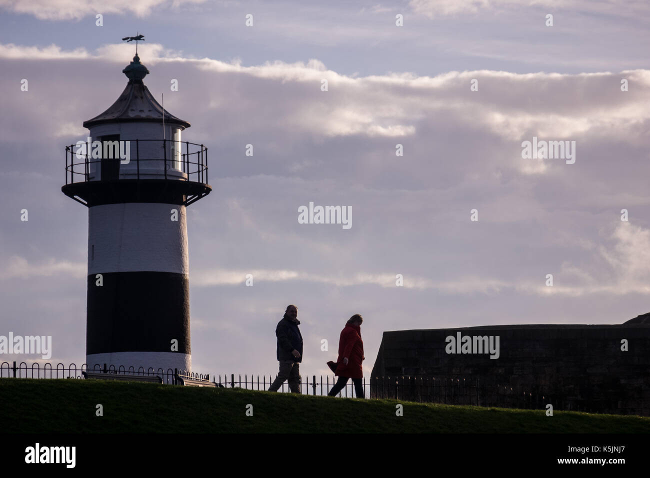 People taking a morning walk next to Southsea Castle Stock Photo