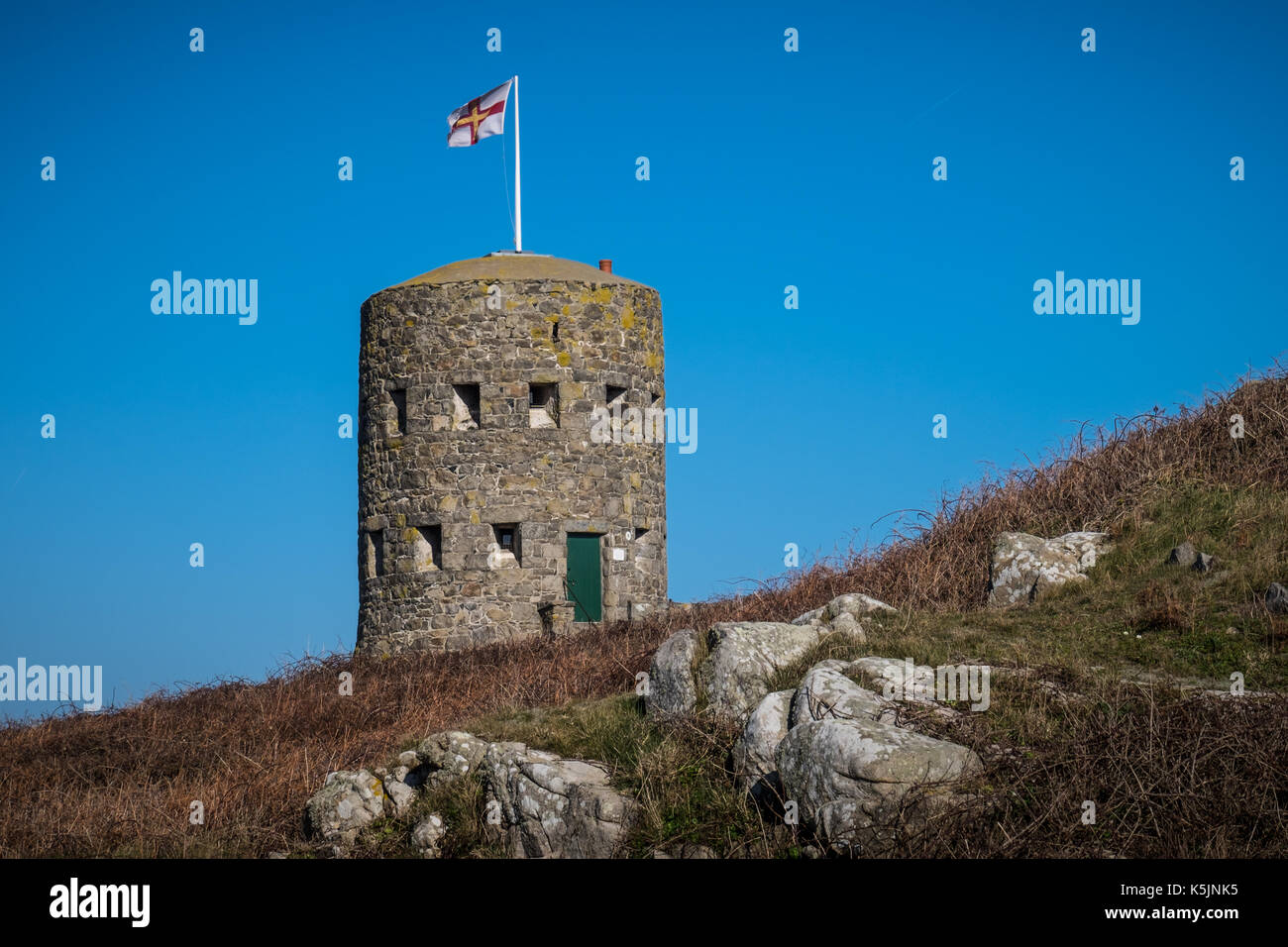 A stone tower at L'Ancresse Bay in Guernsey - Stock Image