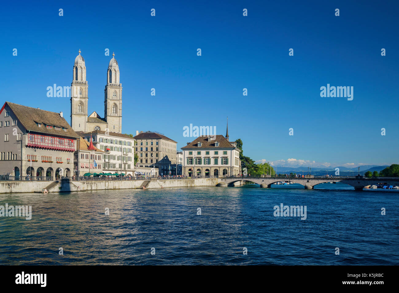 Afternoon cityscape with Great Minster, Limmat river of the historical Zurich city, Switzerland - Stock Image