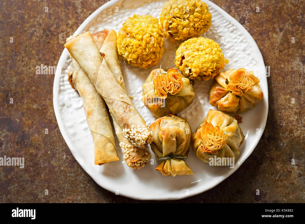 Duck party food selection. Sesame duck cigars, duck moneybags, crispy duck bonbons. - Stock Image