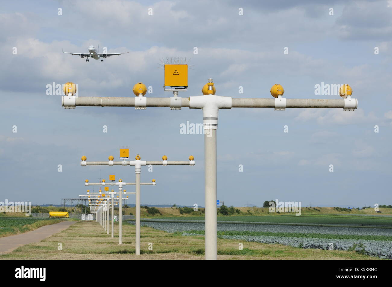 Aircraft and Approach Lights at Airport - Stock Image