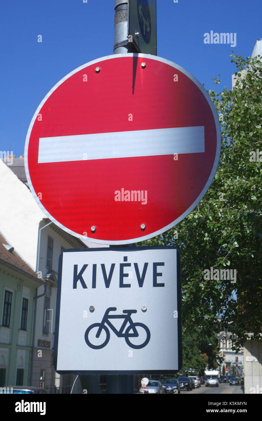 Road sign indicating no entry except for cyclists, in Hungarian, Budapest, Hungary - Stock Image