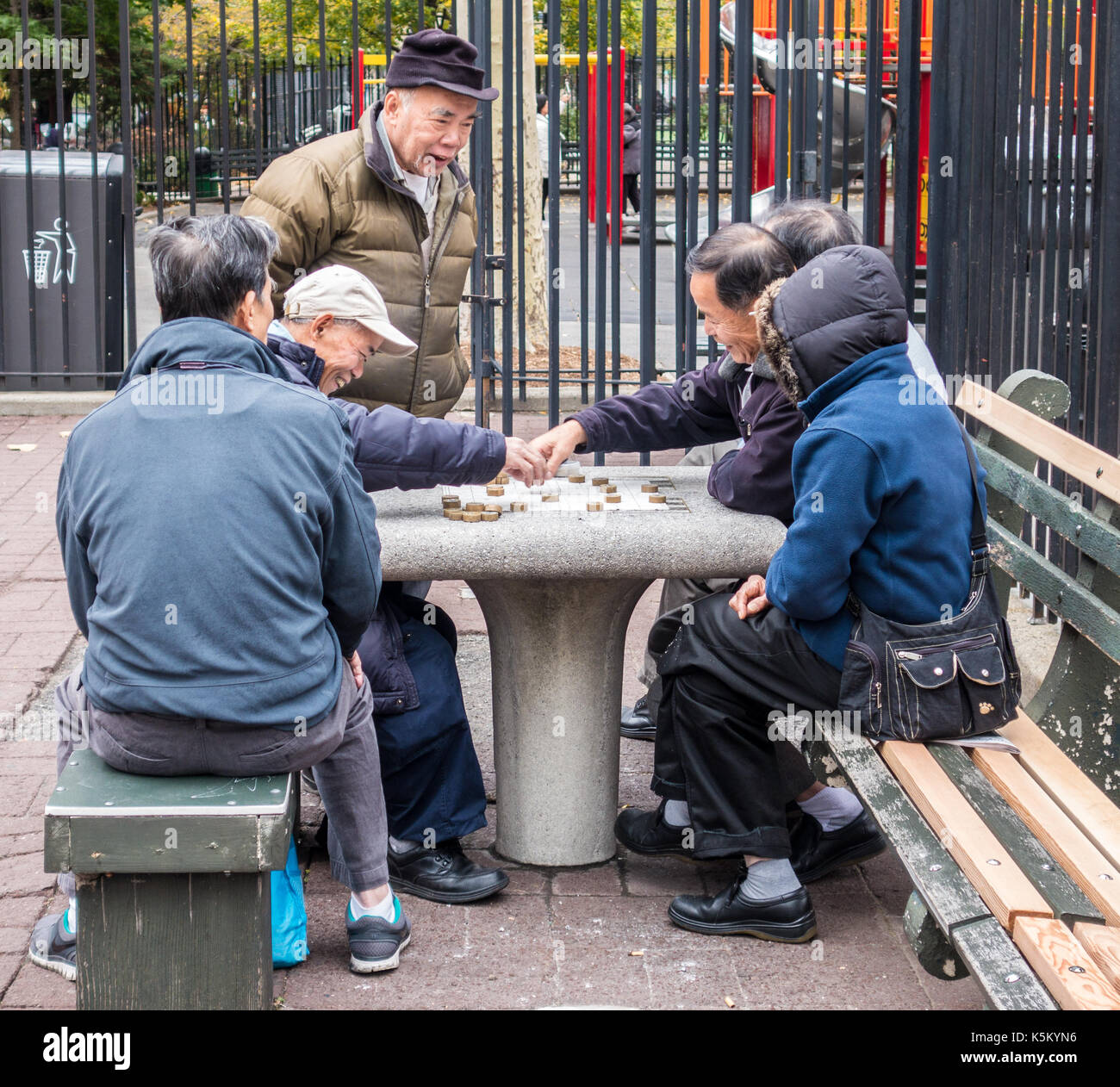 New York City, New York - Nov 5, 2014: Men play mahjong in Chinatown park - Stock Image
