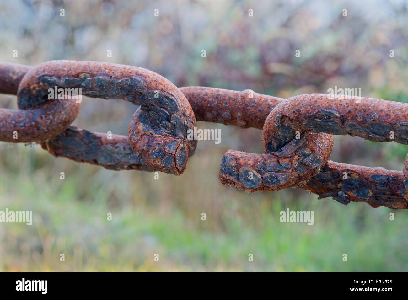 Connecting rusty chain links, exposed to Coastal Climate. - Stock Image
