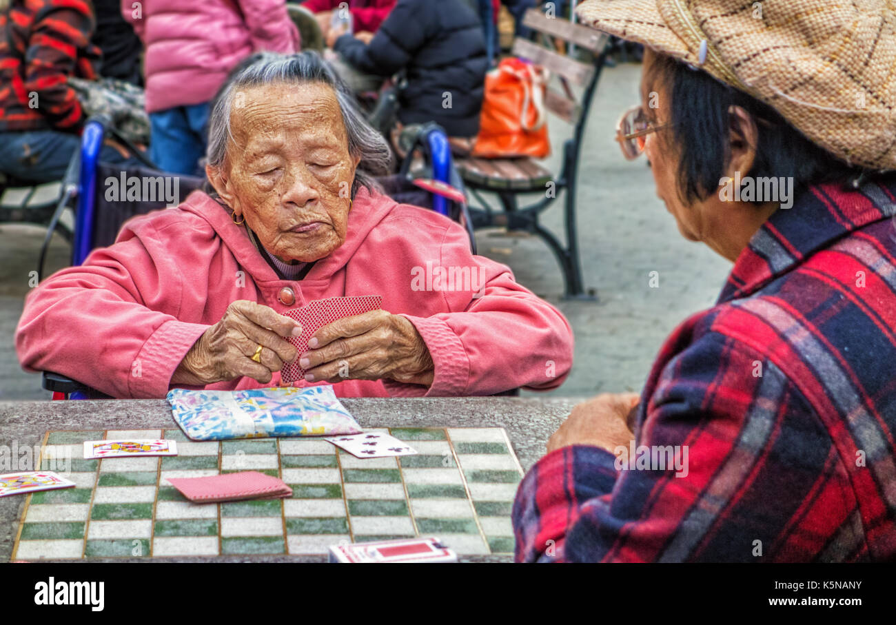 New York City, New York - Nov 5, 2014: Women play cards in Chinatown park - Stock Image