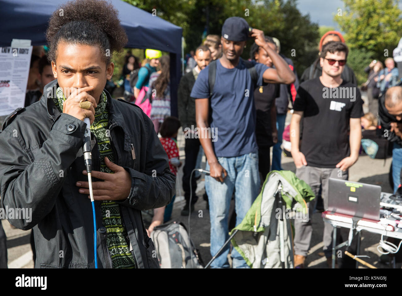 London, UK. 9th September, 2017. Rapper Logic's People's Army perform for activists from many different campaign and faith groups protesting outside the ExCel Centre against the arms trade and the arms fair to be held at the venue next week. DSEI is the world's largest arms fair and military delegations invited by the British government include states named by the Foreign Office as a 'human rights priority', namely Bahrain, Colombia, Egypt, Pakistan and Saudi Arabia. Credit: Mark Kerrison/Alamy Live News - Stock Image