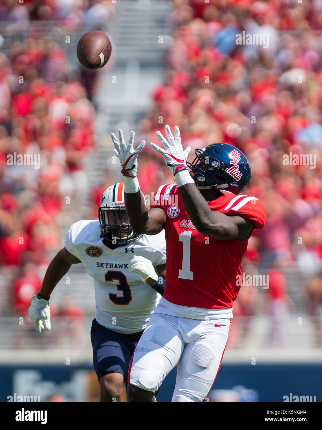 Oxford, USA.  9th Sept 2017. University of Mississippi Wide Receiver A.J. Brown (1) waits to catch the pass from Quarterback Shea Patterson (20) as University of Tennesse-Martin Safety Tae Martin (3) gives chase during the first quarter at Vaught-Hemingway Stadium in Oxford, Mississippi,  on Saturday, September 9, 2107.  Credit: Kevin Williams/Alamy Live News. - Stock Image