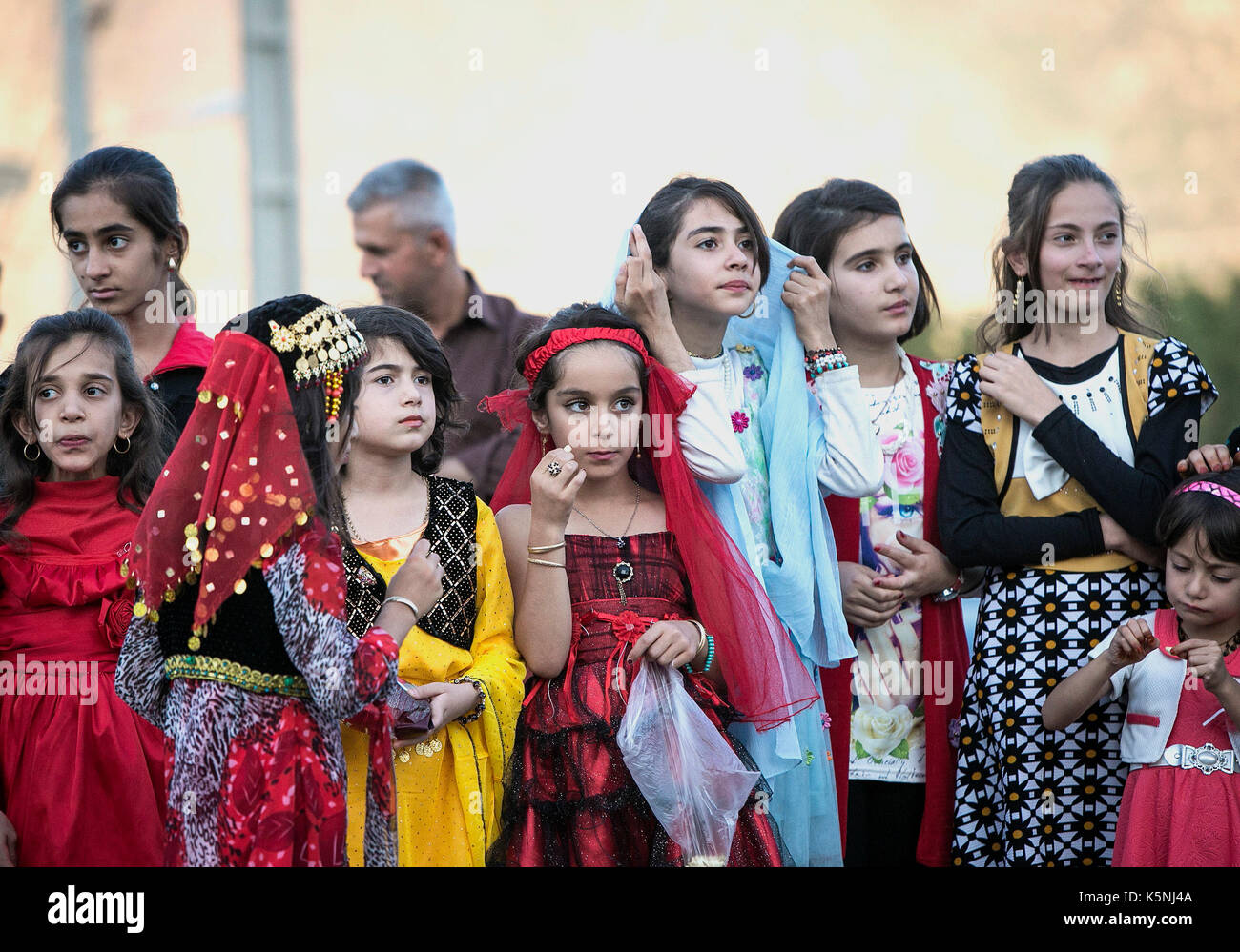 Marivan, Iran. 9th Sep, 2017. Iranian girls wearing local costumes watch a performance during the 12th International Street Theater Festival in Marivan, western Iran, Sept. 9, 2017. Credit: Ahmad Halabisaz/Xinhua/Alamy Live News - Stock Image