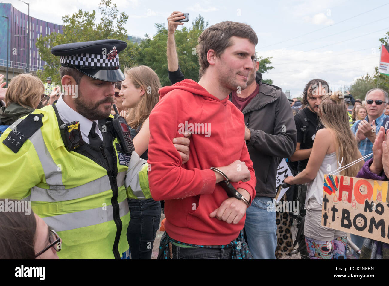 London, UK. 9th Sep, 2017. London, UK. 9th September 2017. Police lead away one of the protesters who had blocked Stock Photo