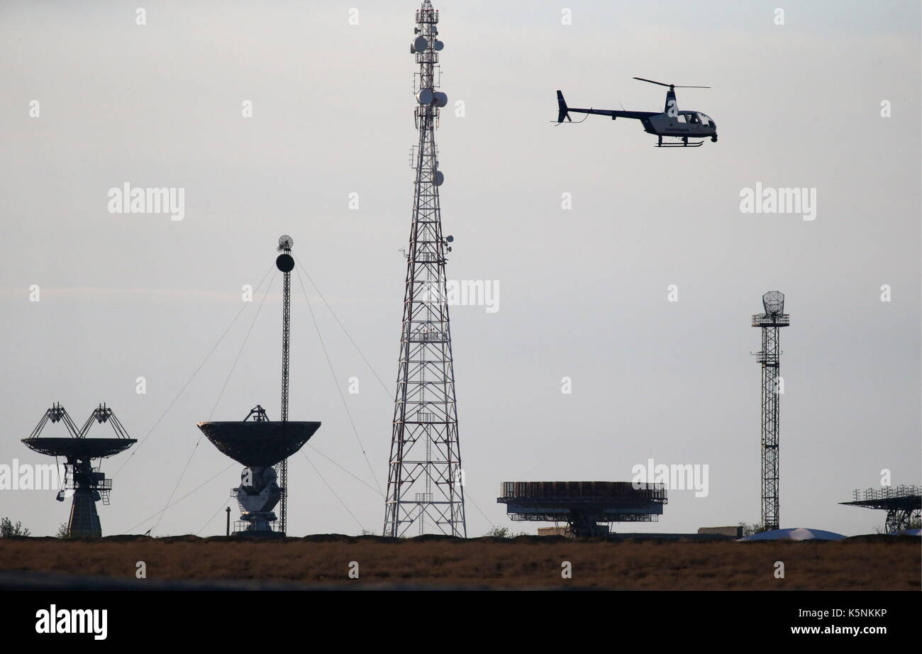 KAZAKHSTAN - SEPTEMBER 10, 2017: A helicopter flying over a launch pad at the Baikonur Cosmodrome. Peter Kovalev/TASS - Stock Image
