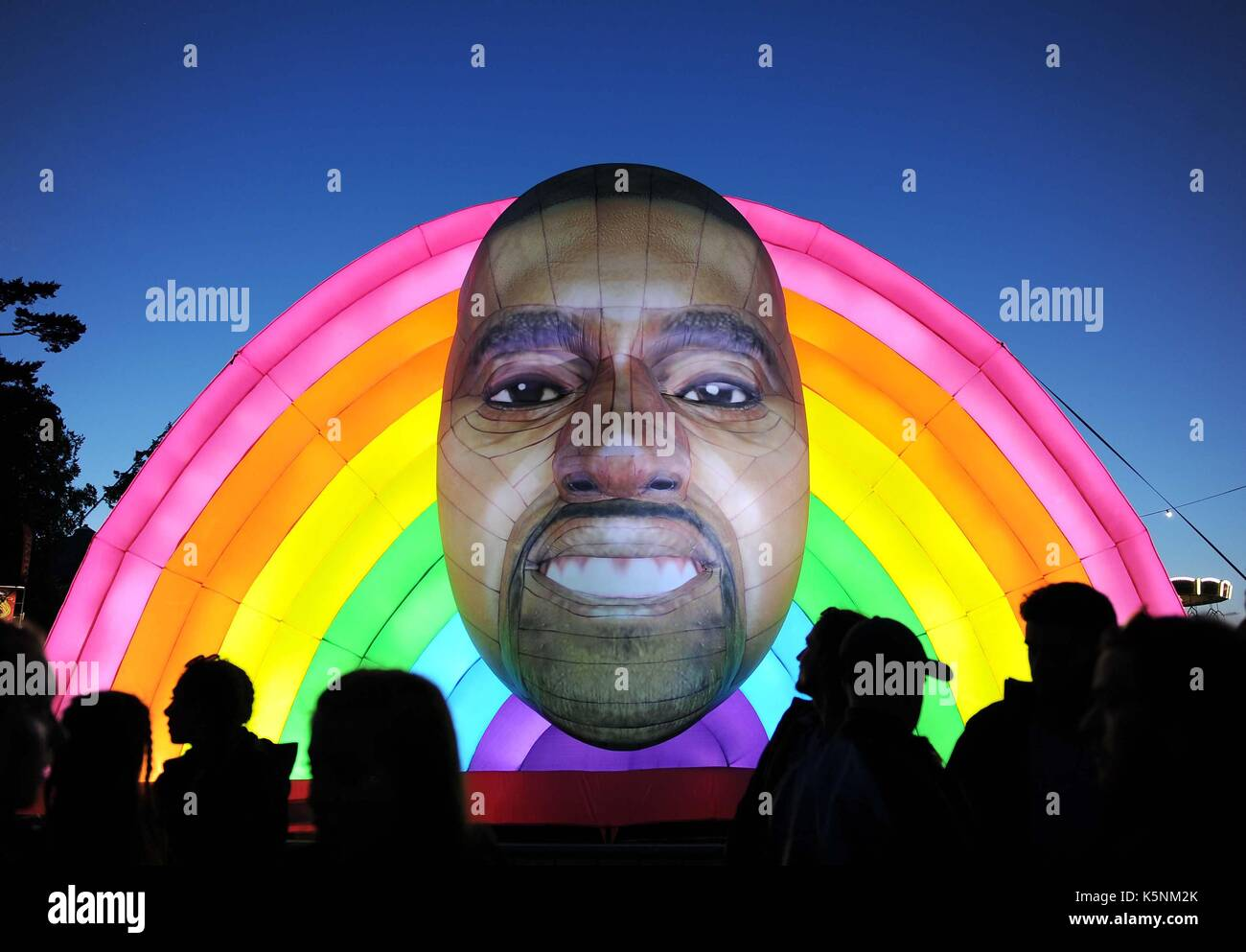 Inflatable Kanye West at Bestival Music Festival. Inflatable Kanye West Credit: Finnbarr Webster/Alamy Live News - Stock Image