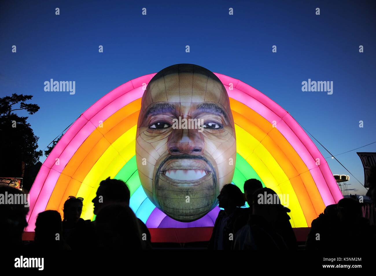 Inflatable Kanye West at Bestival Music Festival. Inflatable Kanye West Credit: Finnbarr Webster/Alamy Live News Stock Photo