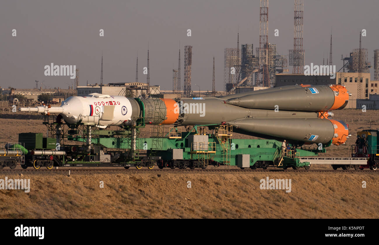 The Russian Soyuz rocket and Soyuz MS-06 spacecraft are rolled by train to the Baikonur Cosmodrome launch pad in - Stock Image