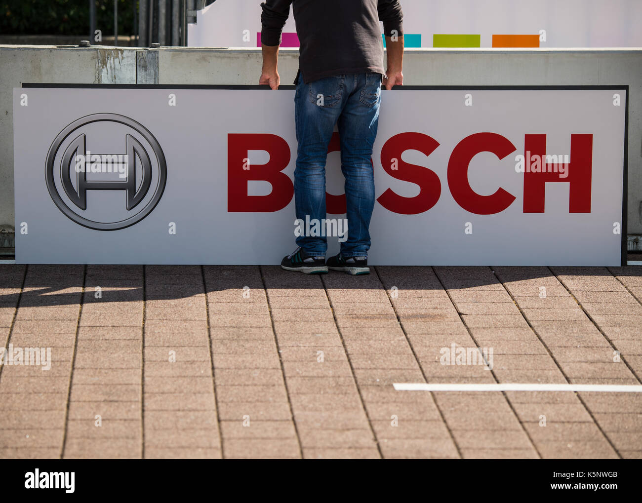 The logo of car parts supplier Bosch is visible on a box on the