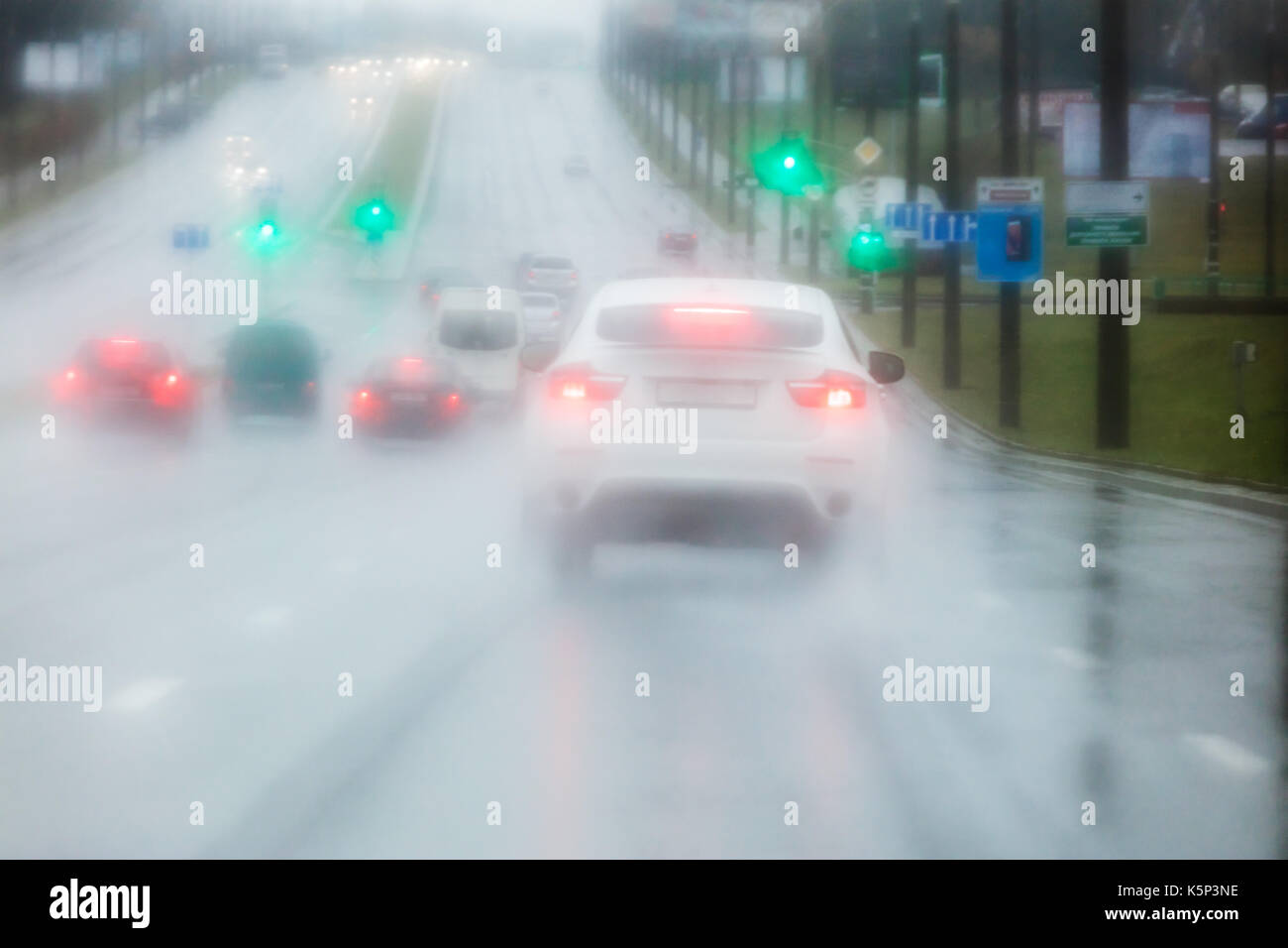 road blurred view through car windshield during heavy rain - Stock Image