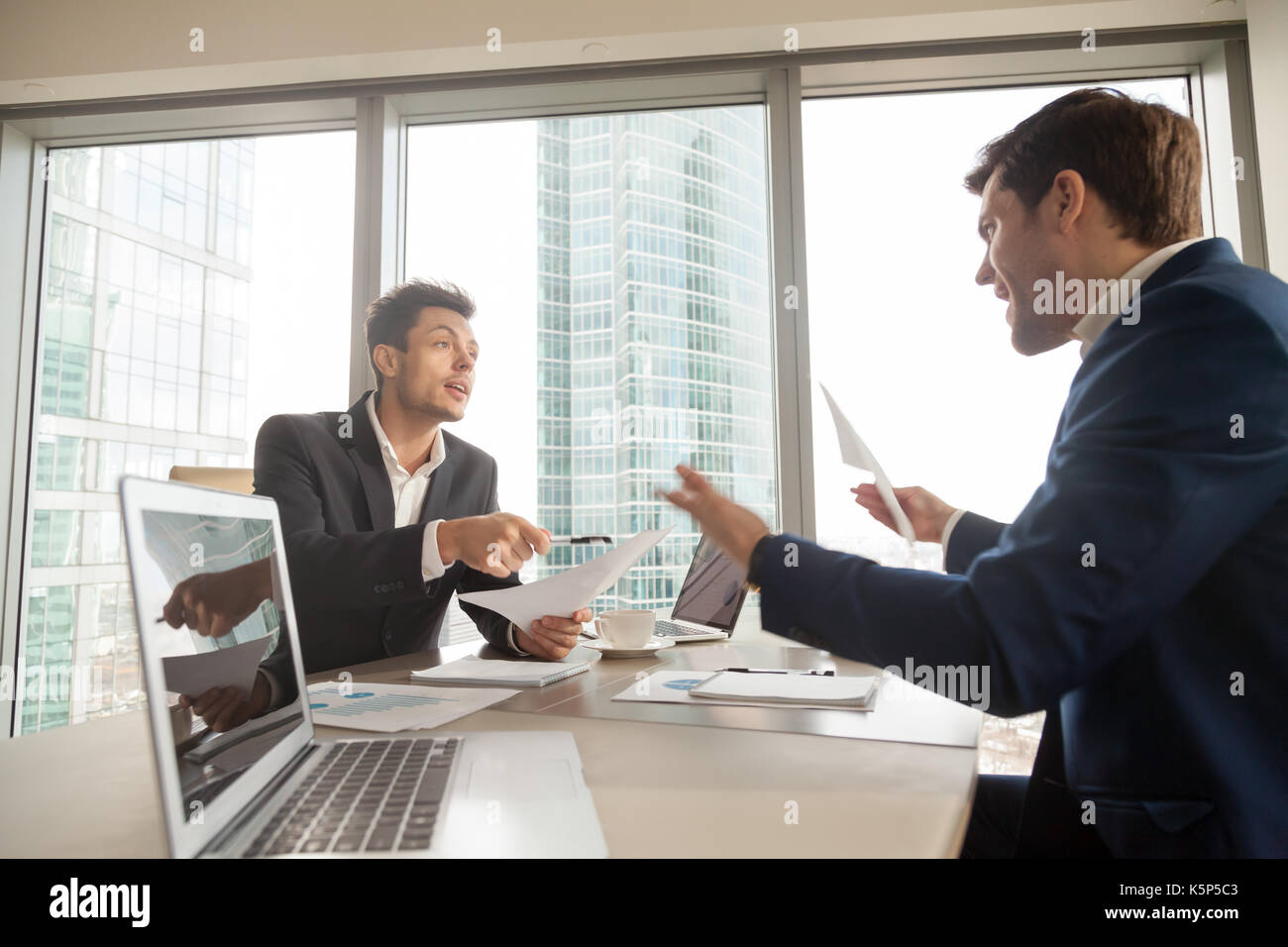 Angry businessman arguing with partner on meeting - Stock Image