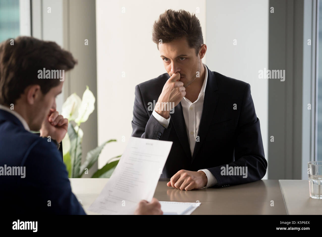 Worried job applicant waiting hiring decision - Stock Image