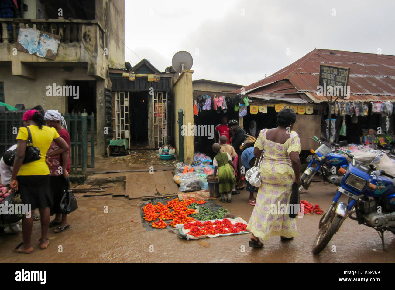 People selling different goods in the street in the city of Lagos, the largest city in Nigeria and the African co - Stock Image