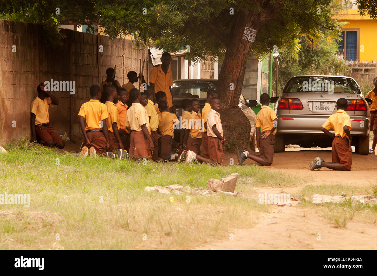 Pupils being punished in Ghanaian school - Stock Image