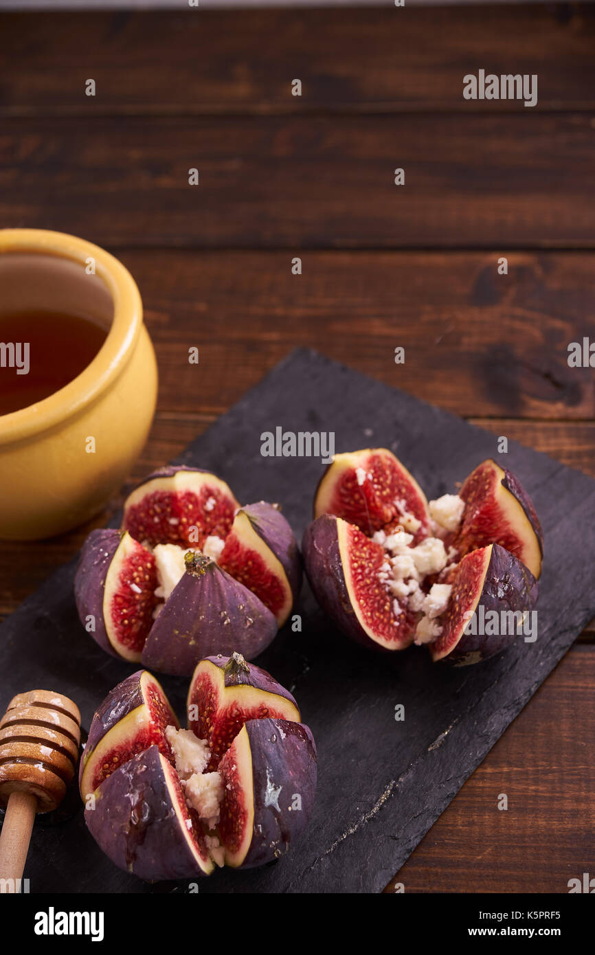 Delicious dessert made with figs fruit, cheese and honey - Stock Image