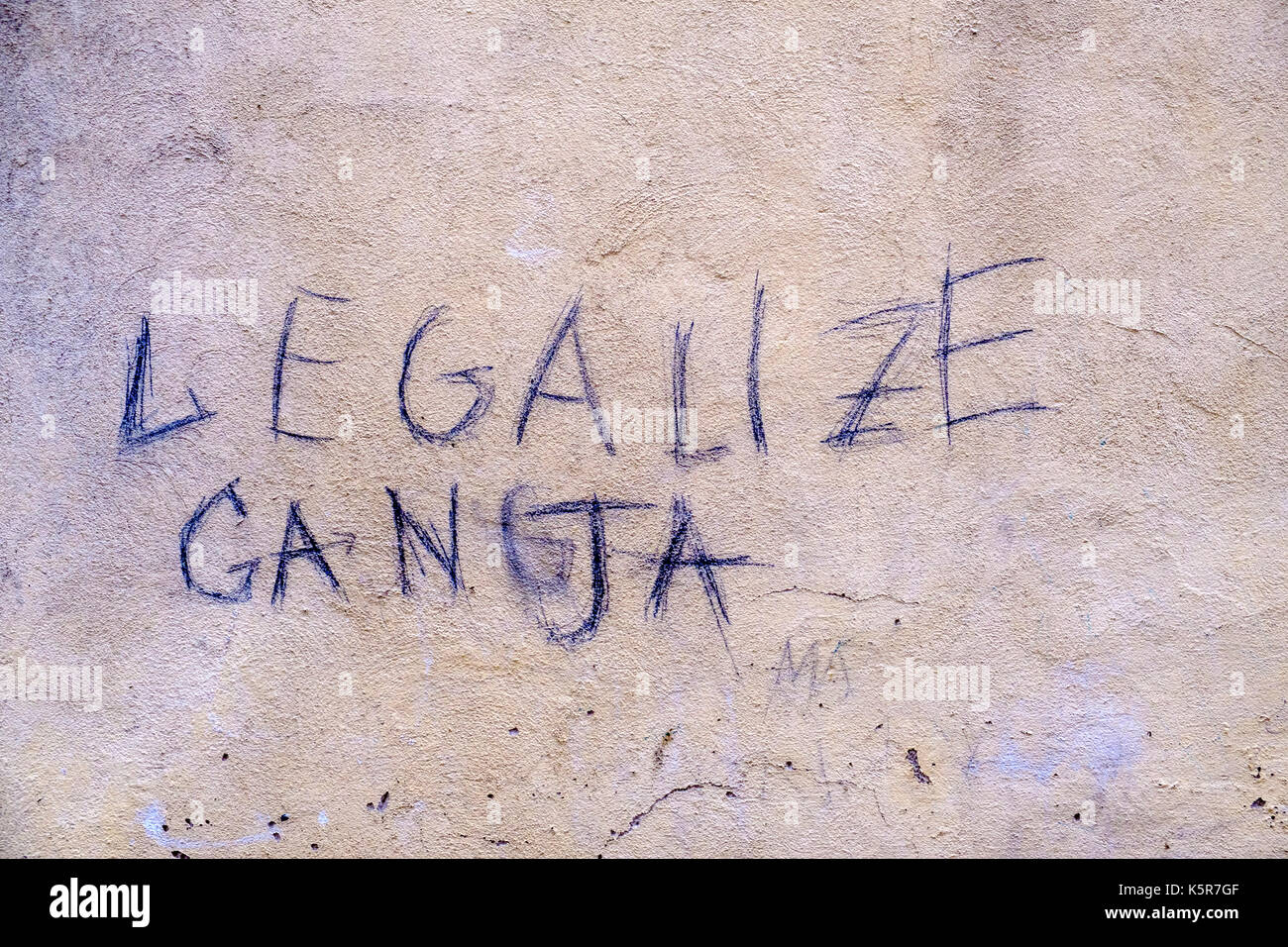 Legalize Ganja, graffity for legalizing marihuana written at a white house wall - Stock Image