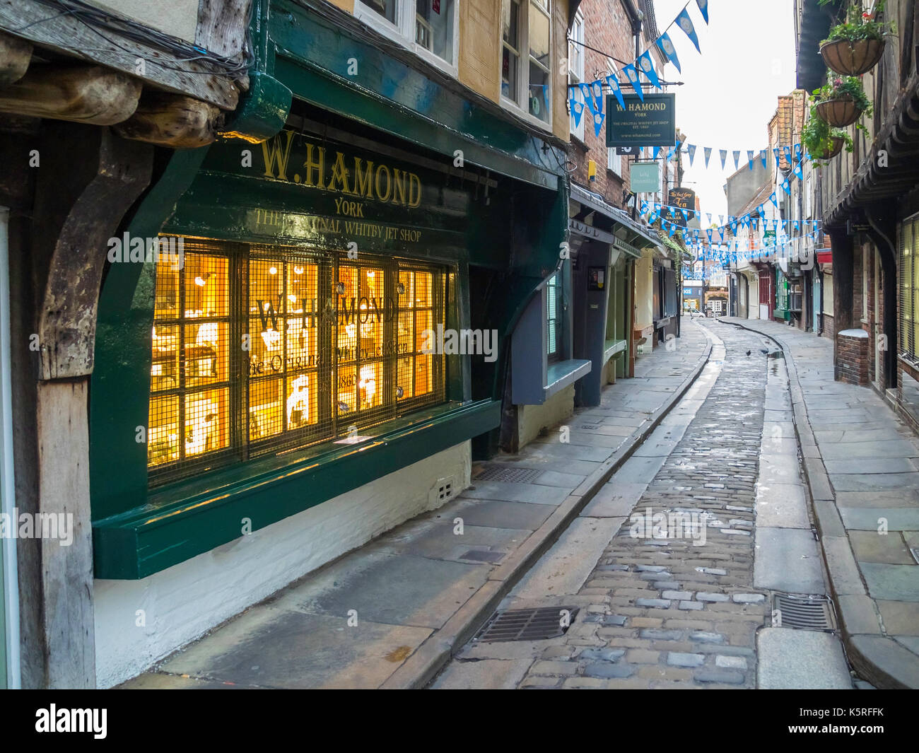 Looking along The Shambles historic medieval street in the centre of York City in the early morning without people - Stock Image