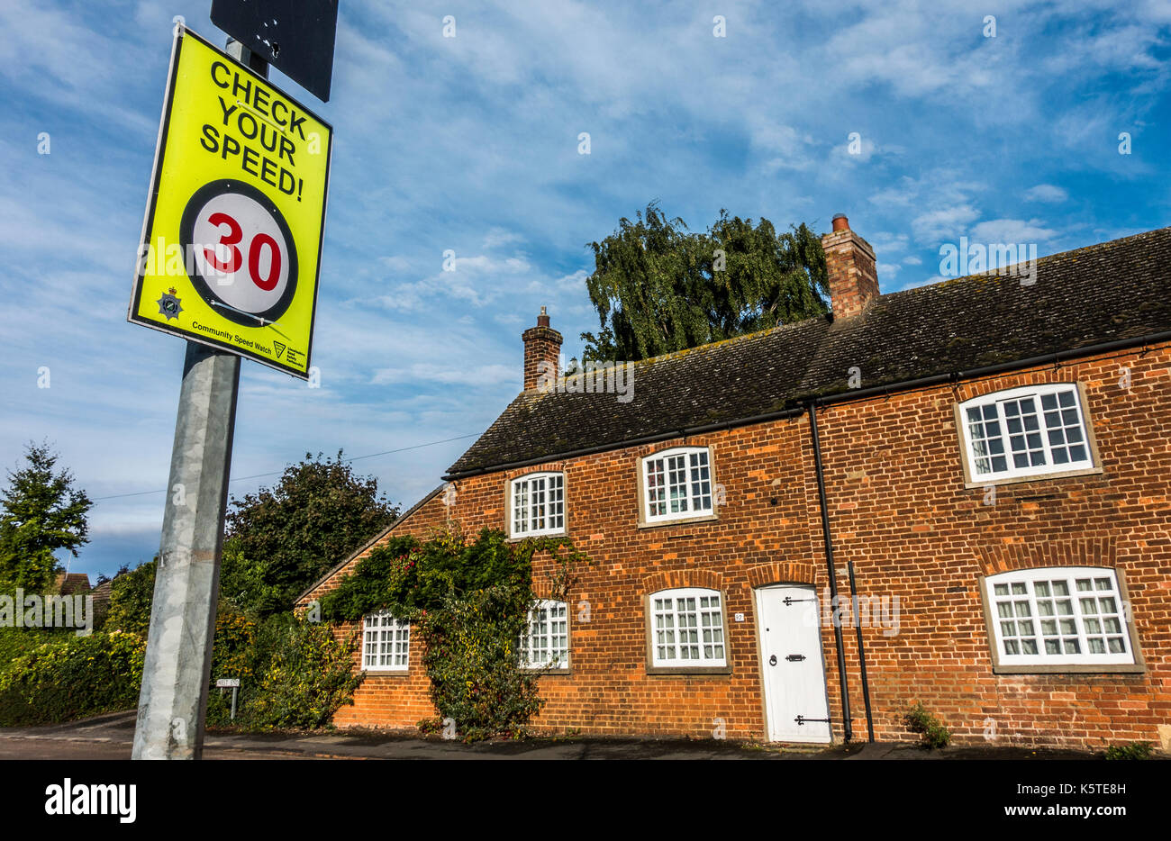 Community Speed Watch 'Check your speed' warning sign on a 30 miles per hour legal limit road, in a built up area of Lincolnshire, England, UK. - Stock Image