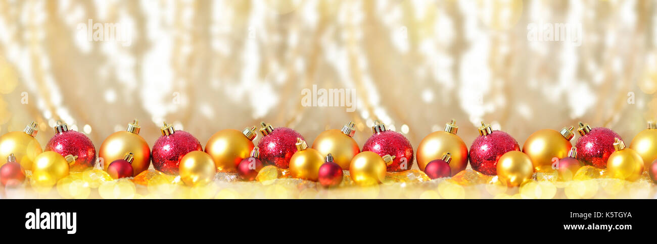 christmas new year composition with gold red balls row line background holiday decoration toy concept long banner