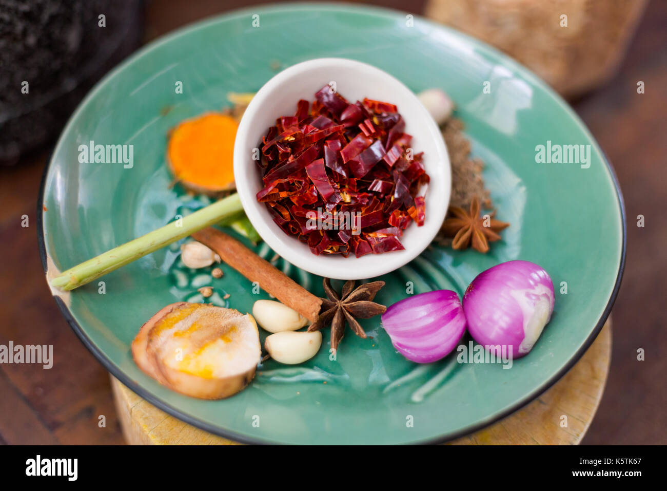Massaman hot curry paste ingredients. Picture of traditional thai cuisine made of fresh ingredients taken during cooking class in Chiang Mai. - Stock Image