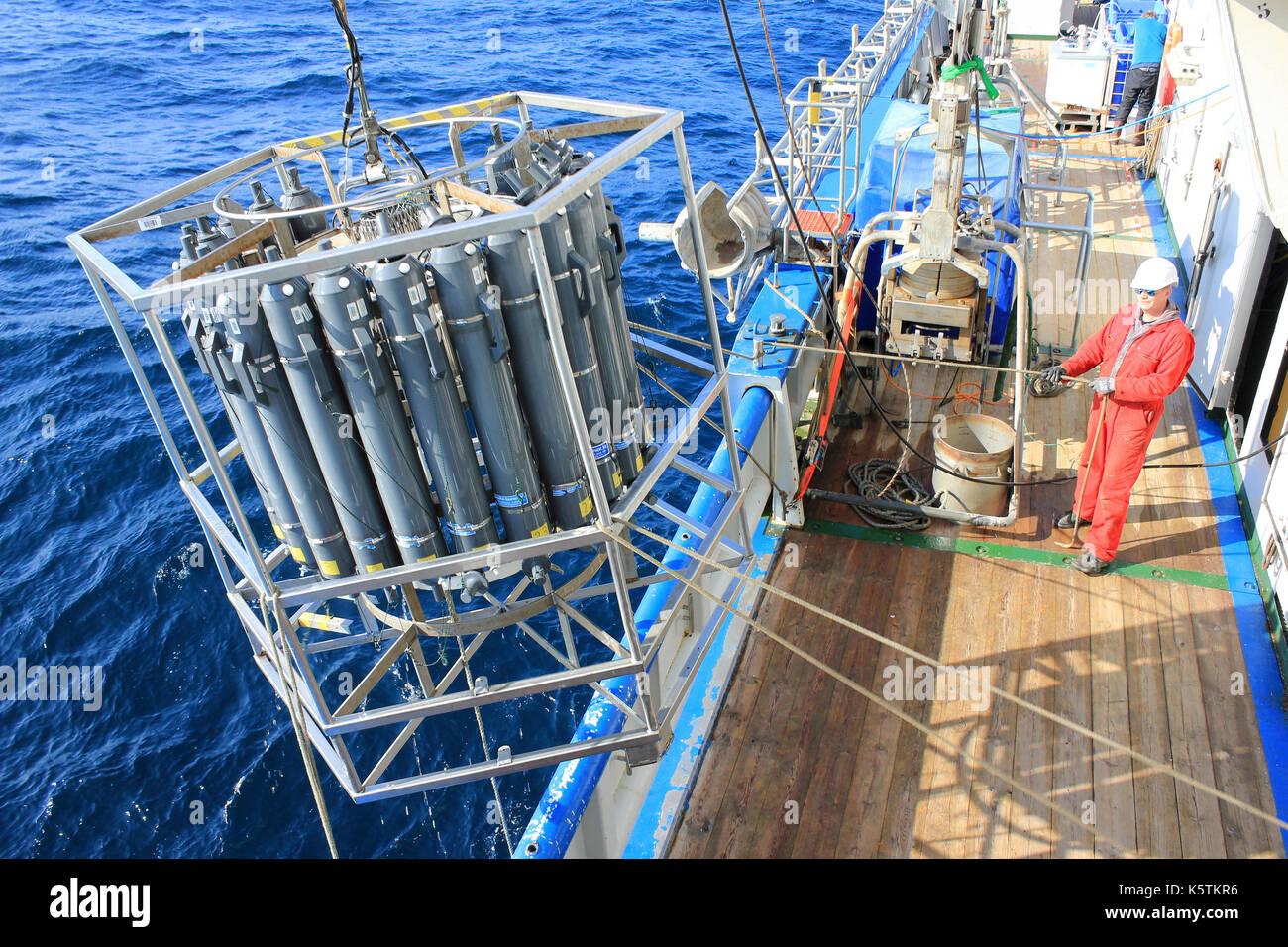 Deploying a CTD Rosette for sampling water Conductivity, Temperature, Depth - Stock Image