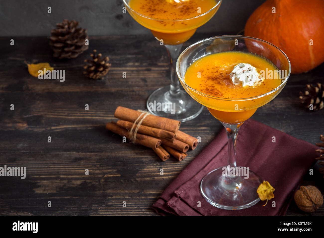 Fall Seasonal Drinks. Thanksgiving and Halloween Cocktails. Margarita Cocktail with Pumpkin Pie Spices and Whipped Stock Photo