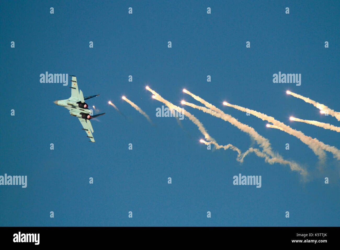 Military aviation. Sukhoi Su-27 Flanker fighter jet aircraft of the Ukraine Air Force releasing flares - Stock Image