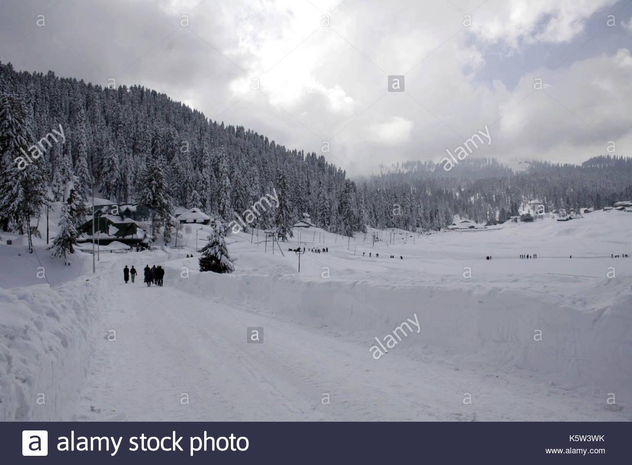 gulmarg ski resort. skiers hit the slopes at a ski resort in gulmarg