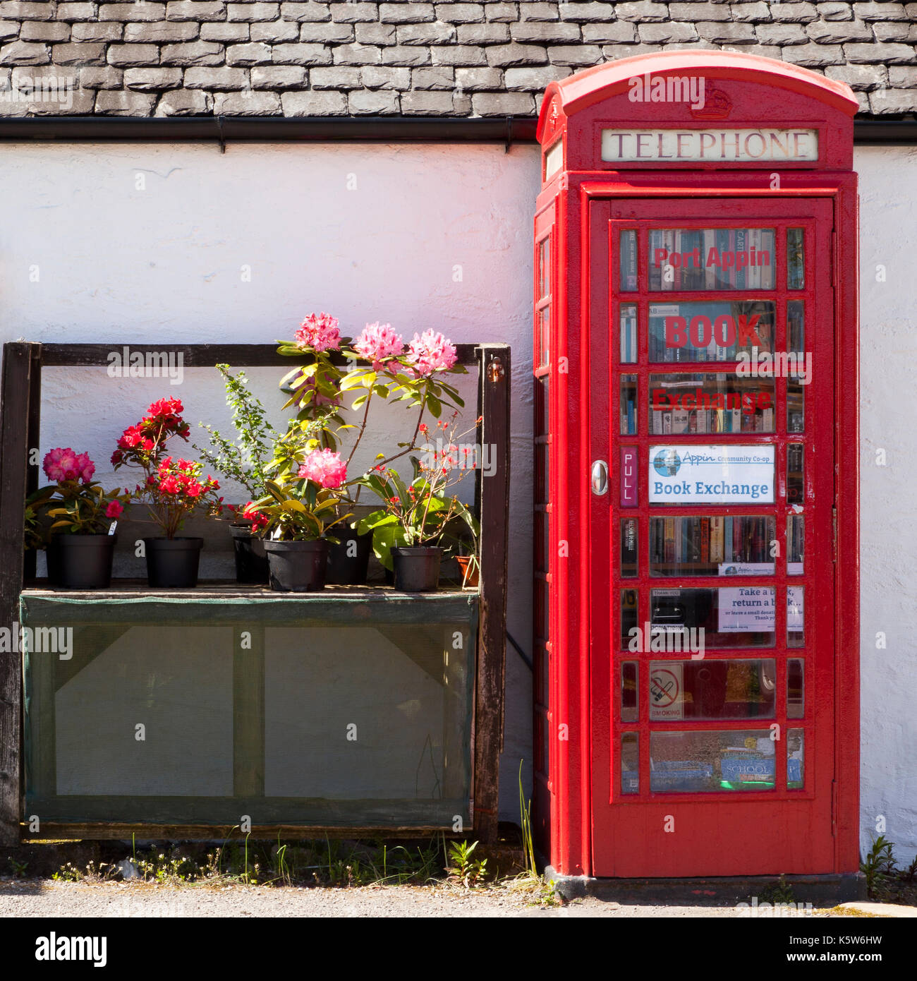 Port Appin Book Exchange in an old Telephone box, Scotland, UK - Stock Image