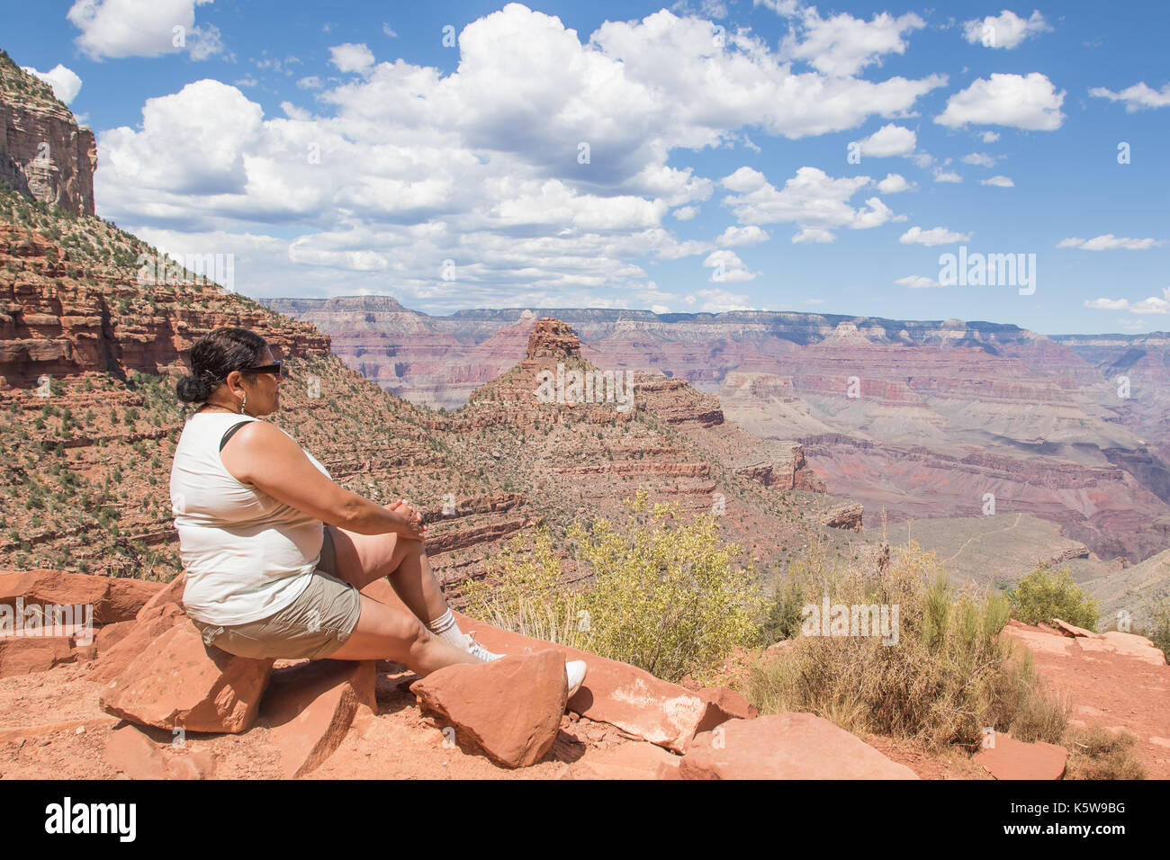 Asian woman enjoying the view of the Grand Canyon from the Bright Angel Trail Stock Photo