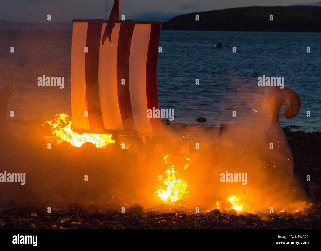The burning of a Viking longship in Scotland.  The Battle of Largs (2 October 1263) Re-enactment event by the Swords of Dalriada, 13th Century, living history group. - Stock Image