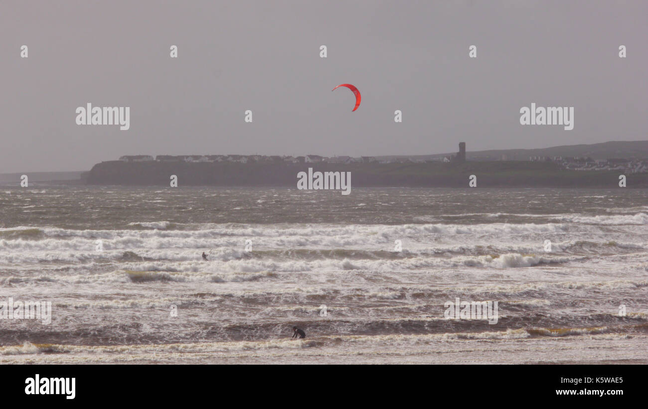 The storm approaches. Beach activity along the West coast of Ireland before the storm and wild weather arrives. - Stock Image