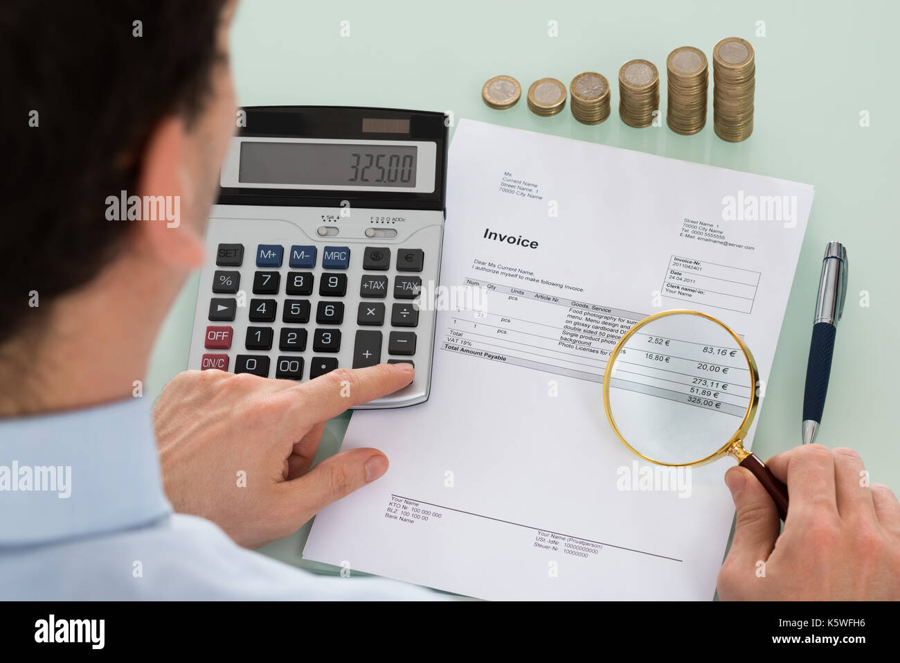 Photo Of Auditor Examining Invoice With Magnifying Glass - Stock Image