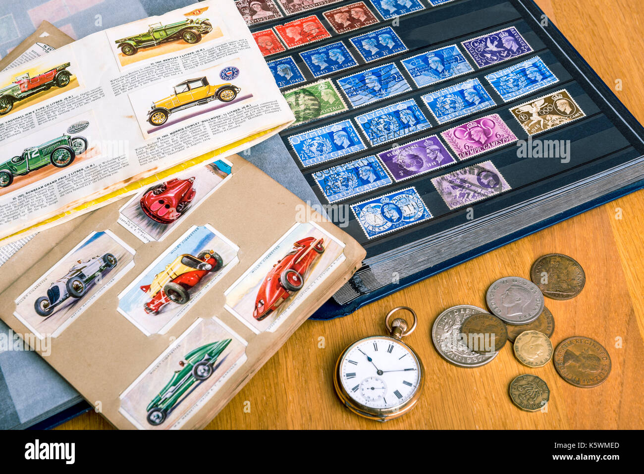 Stamps, cigarette cards, coins, watch. Collectable collection, nostalgia memories. - Stock Image