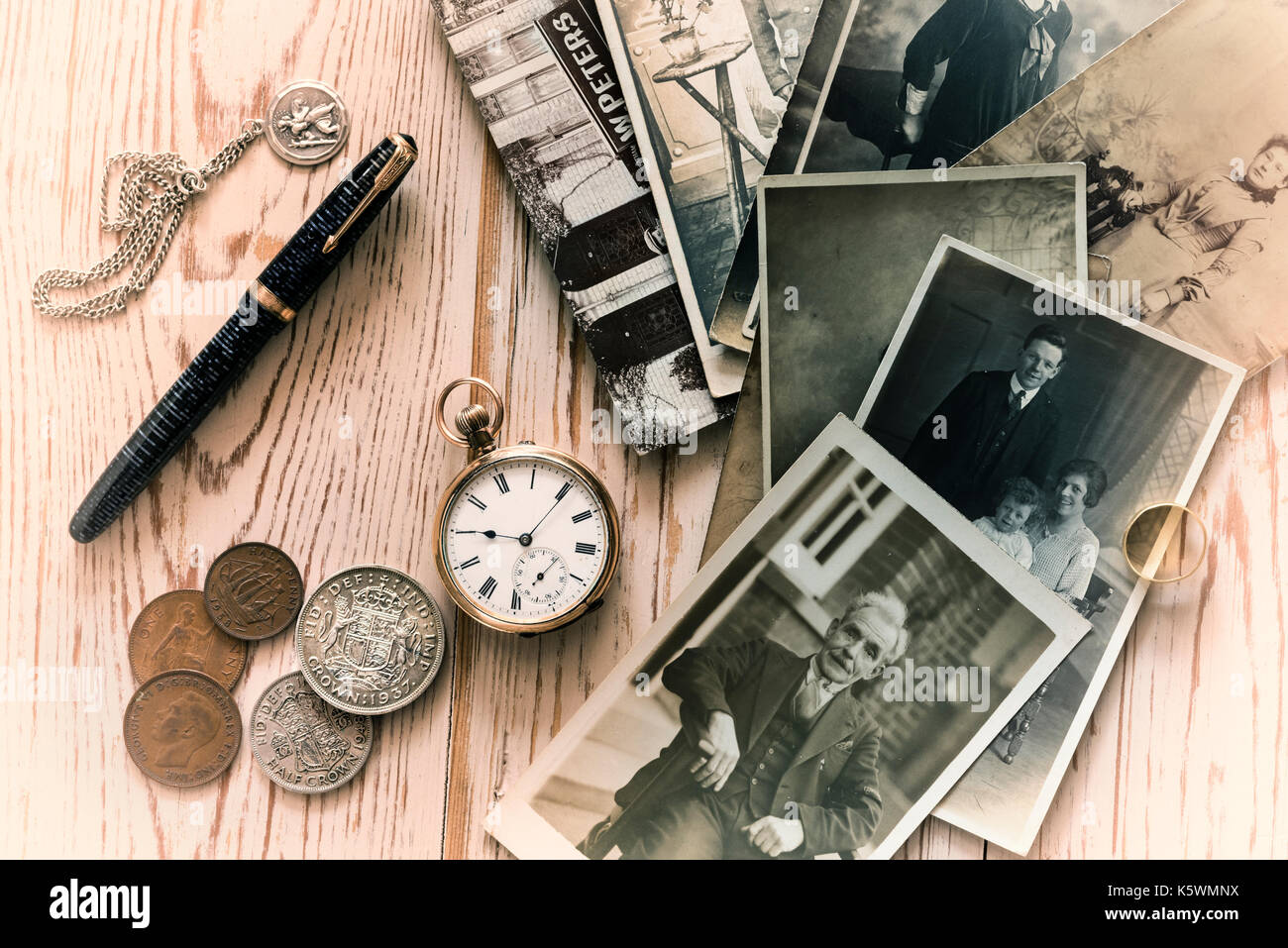 Old family photographs and some collectable items. Nostalgia, memories. - Stock Image
