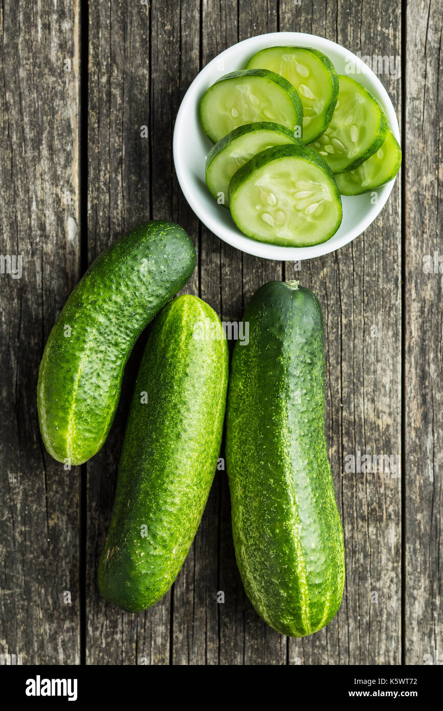 Sliced green cucumbers. Cucumbers in bowl. Top view. - Stock Image